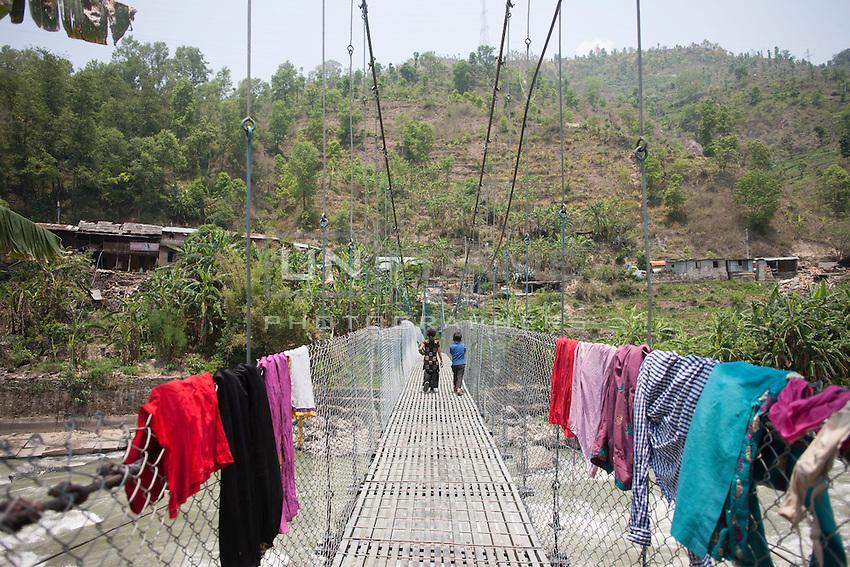 Nepalese children walk on a bridge at Shila Porbot, outskirts of Kathmandu, Nepal. May 8, 2015