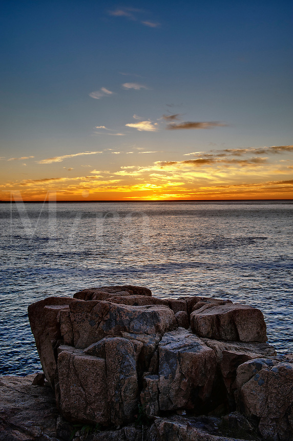 Granite boulder coastline looking out to the ocean sunrise, Acadia National Park, Maine, USA