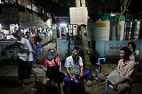 People wait for results of their HIV tests outside the HIV/AIDS hospice, founded by a member of the National League for Democracy (NLD) party in suburbs of Yangon May 27, 2012.   REUTERS/Damir Sagolj (MYANMAR)