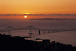 Sunset mouth of the Columbia River opening into the Pacific ocean with the Astoria-Megler bridge silhouetted linking Washington State with Oregon State Astoria Oregon State USA