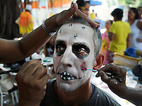 "A patient from mental health hospital Nise da Silveira has his face painted for the institute's carnival parade for participate at ""Loucura Suburbana,""  (Suburban Madness) carnival group, Rio de Janeiro, Brazil, February 12, 2015. Patients, their relatives and workers from the institute held their parade one day before the official start of Carnival.."