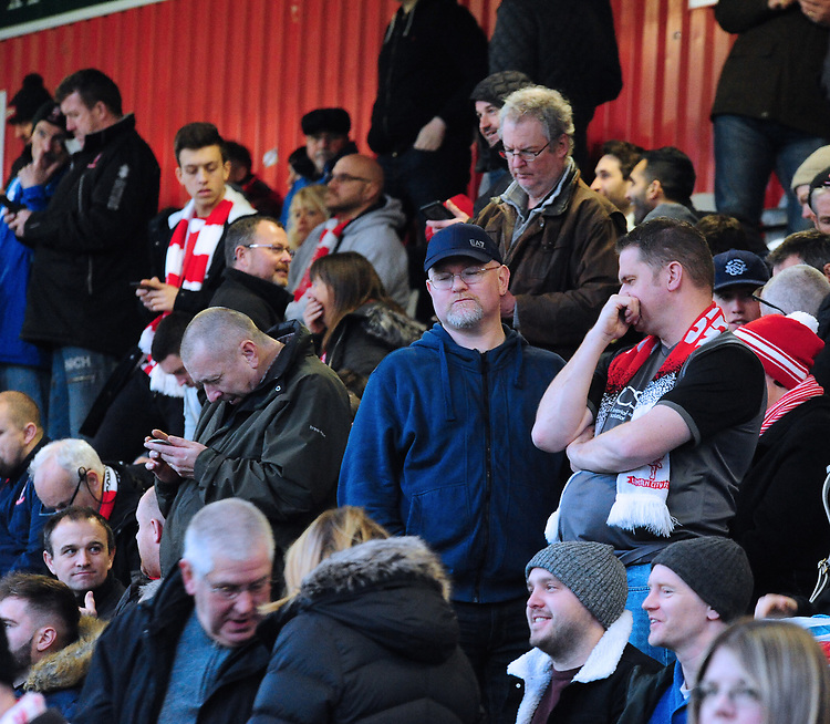 Lincoln City fans watch their team in action<br /> <br /> Photographer Andrew Vaughan/CameraSport<br /> <br /> The EFL Sky Bet League Two - Stevenage v Lincoln City - Saturday 8th December 2018 - The Lamex Stadium - Stevenage<br /> <br /> World Copyright © 2018 CameraSport. All rights reserved. 43 Linden Ave. Countesthorpe. Leicester. England. LE8 5PG - Tel: +44 (0) 116 277 4147 - admin@camerasport.com - www.camerasport.com