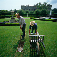 Two gardeners laying turf in the garden at Longleat