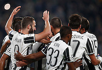 Calcio, Champions League: Gruppo H, Juventus vs Lione. Torino, Juventus Stadium, 2 novembre 2016. <br /> Juventus&rsquo; Gonzalo Higuain, left, celebrates with teammates after scoring on a penalty kick during the Champions League Group H football match between Juventus and Lyon at Turin's Juventus Stadium, 2 November 2016. The game ended 1-1.<br /> UPDATE IMAGES PRESS/Isabella Bonotto