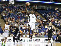 Yorick Williams Pro Basketball Player leaps to score a basket during Hoops Aid 2015 Celebrity AllStars Basketball Match at the o2 Arena, London, England on 10 May 2015. Photo by Andy Rowland.