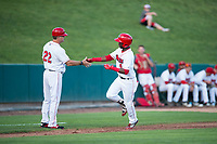 Orem Owlz center fielder D'Shawn Knowles (4) is congratulated by manager Dave Stapleton (22) after hitting a home run during a Pioneer League game against the Ogden Raptors at Home of the OWLZ on August 24, 2018 in Orem, Utah. The Ogden Raptors defeated the Orem Owlz by a score of 13-5. (Zachary Lucy/Four Seam Images)
