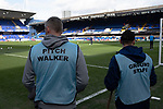 Two members of the ground staff survey the pitch before Ipswich Town play Oxford United in a SkyBet League One fixture at Portman Road. Both teams were in contention for promotion as the season entered its final months. The visitors won the match 1-0 through a 44th-minute Matty Taylor goal, watched by a crowd of 19,363.