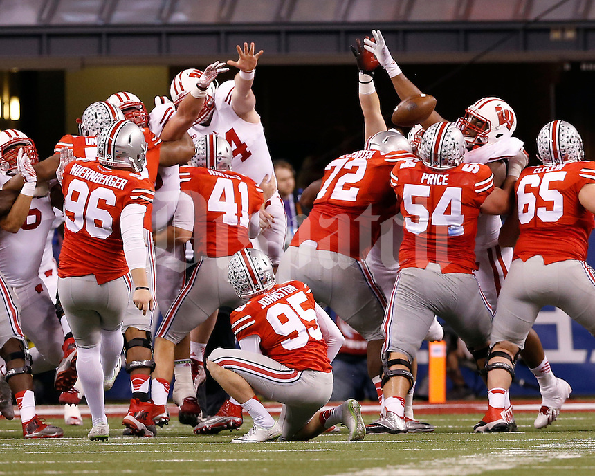 Ohio State Buckeyes place kicker Sean Nuernberger (96) has a field goal blocked during the fourth quarter of the Big Ten Championship game against the Wisconsin Badgers at Lucas Oil Stadium in Indianapolis on Dec. 6, 2014. (Adam Cairns / The Columbus Dispatch)