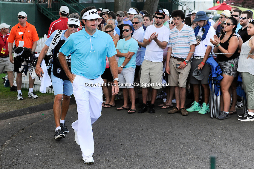June 22, 2014 - Cromwell, Connecticut - Bubba Watson makes his way past spectators to the 18th tee box during the final round of the PGA Travelers Championship tournament held at TPC River Highlands in Cromwell, Connecticut.  Eric Canha/CSM