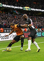 Wolverhampton Wanderers' Adama Traore shields the ball from Newcastle United's Jetro Willems <br /> Photographer Lee Parker/CameraSport<br /> <br /> The Premier League - Wolverhampton Wanderers v Newcastle United - Saturday 11th January 2020 - Molineux - Wolverhampton<br /> <br /> World Copyright © 2020 CameraSport. All rights reserved. 43 Linden Ave. Countesthorpe. Leicester. England. LE8 5PG - Tel: +44 (0) 116 277 4147 - admin@camerasport.com - www.camerasport.com