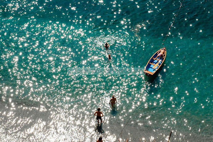 Boating and swimming in the clear turquoise waters of the Amalfi Coast, Italy