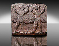 "Picture of Neo-Hittite orthostat describing the legend of Gilgamesh from Karkamis,, Turkey. Symetrical mythological Scene depicting ""Winged Griffin Demons"", half men with birds heads & wings. Their hands are raised above their heads supposidly carrying the sky. An Ankara Museum of Anatolian Civilizations exhibit."