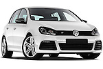 Low aggressive passenger side front three quarter view of a 2011 Volkswagen Golf R 5 Door Hatchback Stock Photo