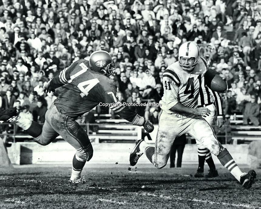 Baltimore Colts Tom Matte chased by San Francisco 49ers Clark Miller, NFL game at Kezar Statium in San Francisco. (1966 photo by Ron Riesterer/photoshelter.<br /><br /><br />(photo Dec 19-20, 1966 by Ron Riesterer)