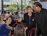 """Campo owner Sanjay Lillaneu greets guests during the """"Reno Taste"""" launch party  Tuesday, June 13, 2017 on the terrace of Campo Reno."""