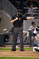 Home plate umpire Randy Rosenberg calls a batter out on strikes during the International League game between the Scranton/Wilkes-Barre RailRiders and the Charlotte Knights at BB&T BallPark on August 13, 2019 in Charlotte, North Carolina. The Knights defeated the RailRiders 15-1. (Brian Westerholt/Four Seam Images)