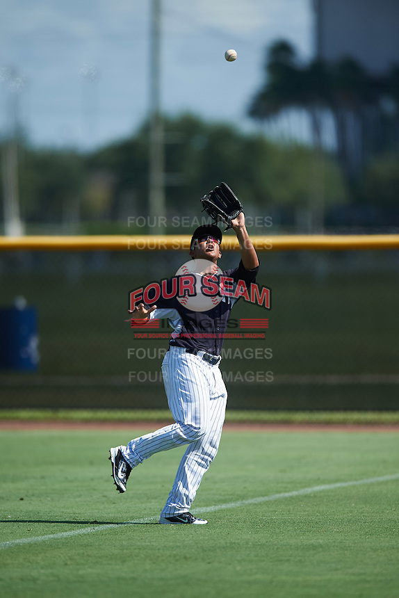 GCL Yankees East right fielder Lisandro Blanco (52) catches a fly ball during a game against the GCL Yankees West on August 3, 2016 at the Yankees Complex in Tampa, Florida.  GCL Yankees East defeated GCL Yankees West 12-2.  (Mike Janes/Four Seam Images)