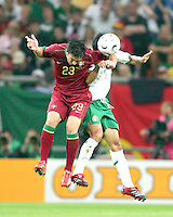 Postiga Helder (23) of Portugal and Ricardo Osorio (5) of Mexico go up for a header. Portugal defeated Mexico 2-1 in their FIFA World Cup Group D match at FIFA World Cup Stadium, Gelsenkirchen, Germany, June 21, 2006.