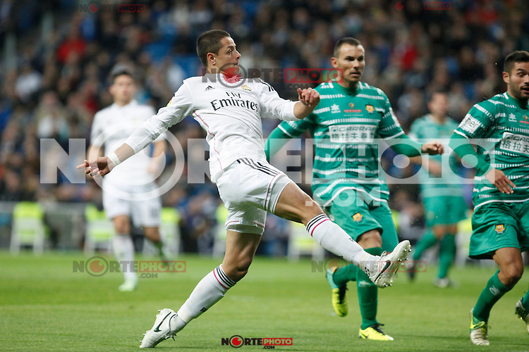 Real Madrid´s Chicharito (L) and Cornella´s Pere during Spanish King Cup match between Real Madrid and Cornella at Santiago Bernabeu stadium in Madrid, Spain.December 2, 2014. (NortePhoto/ALTERPHOTOS/Victor Blanco)