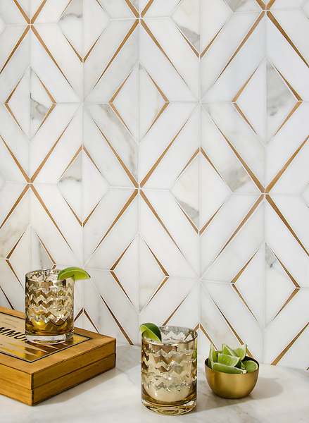 Simone, a waterjet stone mosaic, shown in honed Calacatta Gold, honed Thassos, and brushed Brass, is part of The Studio Line of Ready to Ship mosaics.<br />