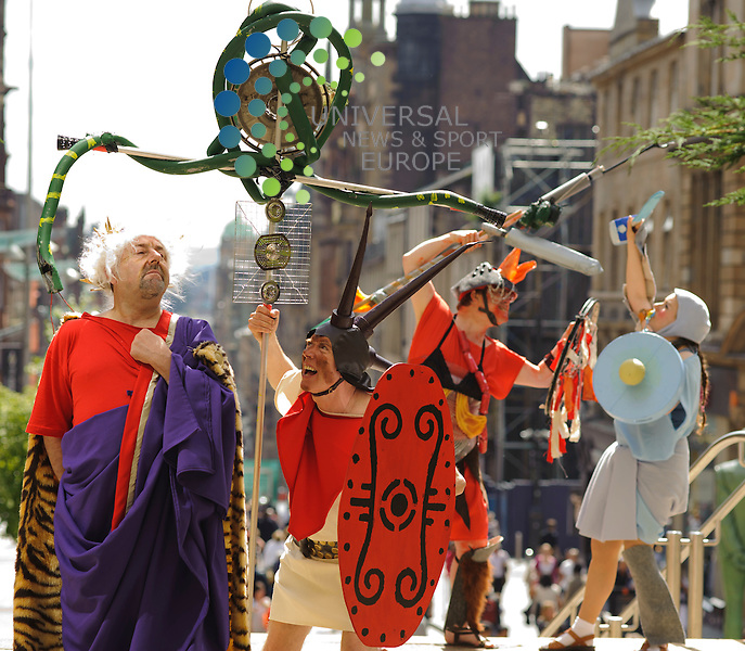Emperor Martin Campbell, Gladiator Calum Beaton, Guard Roger Clifford and gladiator innocence Catherine Taylor part of the Gladiator Parade. Conflux Maximus, Roman Gladiator parade goes through Buchanan Street as part of the Merchant City Festival.The performing arts festival has been organised in partnership with Glasgow's famous Arches venue and will feature Acrobatics as well as various other types of performance arts displays...Sauchiehall Street, Glasgow , Scotland .  Picture: Euan Anderson/Universal News And Sport (Scotland) 23rd July 2010.