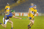 Noel Mc Grath attempts to block the pass of Clare's Podge Collins. Photograph by Declan Monaghan