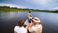 Arriving to Sacha Lodge by dugout canoe in the Amazon Rainforest, Coca, Ecuador, South America