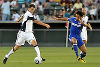 Marko Perovic (white), Stephane Auvray...Kansas City Wizards defeated New England Revolution 4-1 at Community America Ballpark, Kansas City, Kansas.