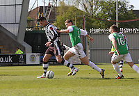 Steven Thompson being pursued by Paul hanlon in the St Mirren v Hibernian Clydesdale Bank Scottish Premier League match played at St Mirren Park, Paisley on 29.4.12.
