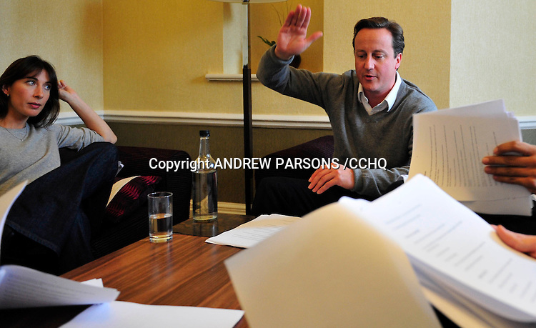 Leader of the Conservative Party David Cameron goes through his speech on the eve of his speech to the Conservative Party Conference with his wife Samantha and William Hague and George Osborne in his room at the Conference Hotel at the Conservative Party Conference in Manchester , Wednesday  October 7 , 2009.