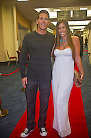 "Andy Irons (HAW) and wife Lyndie  COOLANGATTA, Queensland/Australia (Thursday, February 25, 2010) - . - The ASP World Champions' Crowning took place tonight at the Gold Coast Convention and Exhibition Centre beginning at 6:30pm.. .Surfing's ""night of nights"", the ASP World Champions' Crowning, was a gala event, hosting the world's best surfers as well as distinguished figures from the surfing industry in honour of the 2009 ASP World Champions.. .Mick Fanning (AUS), accepted his second ASP World Champion trophy,  just days before beginning his title defence at his home break of Snapper Rocks, the location of the upcoming Quiksilver Pro Gold Coast .. .Stephanie Gilmore (AUS), 22, reigning three-time ASP Women's World Champion, received her third consecutive ASP Women's World Title cup, and the young natural-footer will soon embark on a campaign to make it a four-peat in 2010. No other surfer in the history of the sport has won three world title from three attempts. Gilmore won her first title in her Rookie year on tour and has won back to back titles since then. Gilmore will begin this weekend at the opening event of the 2010 ASP Women's World Tour season, the Roxy Pro Gold Coast. . .Other ASP Dream Tour athletes  recognised were respective Men's and Women's Runner-Ups Joel Parkinson (AUS),  and Silvana Lima (BRA),  as well as Rookies of the Year Kekoa Bacalso (HAW) and Coco Ho (HAW).. .Harley Ingleby (AUS) and Jennifer Smith (USA) took out the ASP World Longboarding and ASP Women's World Longboarding Titles respectively, while Dan Ross (AUS), and Coco Ho (HAW)  took home hardware for their respective No. 1 finishes on the ASP World Qualifying Series last season...The Men's and Women's World Junior Champions trophies were awarded to Maxime Huscenot (FRA) and Laura Enever (AUS) while ASP  Lifetime Membership was awarded to Layne Beachley (AUS).. .In addition to honouring the champions from 2009, the ASP World Champions' Crowning also recognised athletes who  earnt the"