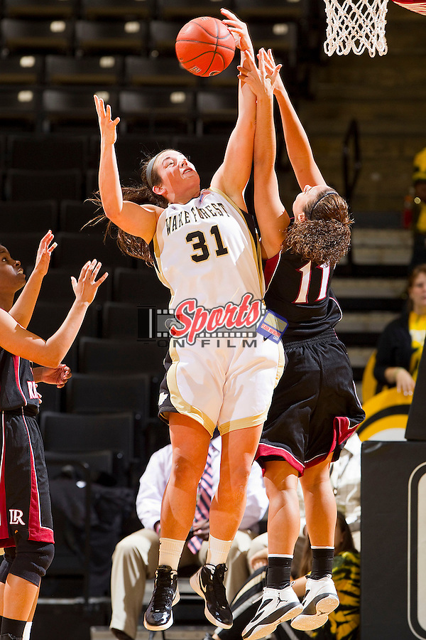 Lindsy Wright #31 of the Wake Forest Demon Deacons grabs a rebound over Alexis Katt #11 of the Lenoir-Rhyne Bears at the LJVM Coliseum on November 2, 2011 in Winston-Salem, North Carolina.  The Demon Deacons defeated the Bears 102-39.  (Brian Westerholt / Sports On Film)