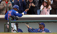 Cubs manager Dusty Baker, right, congratulates Sammy Sosa after scoring a run in the Cubs loss to the Braves in game 4 of the NLDS at Wrigley Field on October 4, 2003.