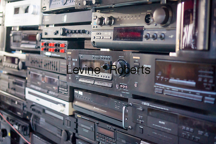 A collection of discarded receivers and other audio equipment waiting to be recycled in New York on Friday, February 20, 2015. (© Richard B. Levine)