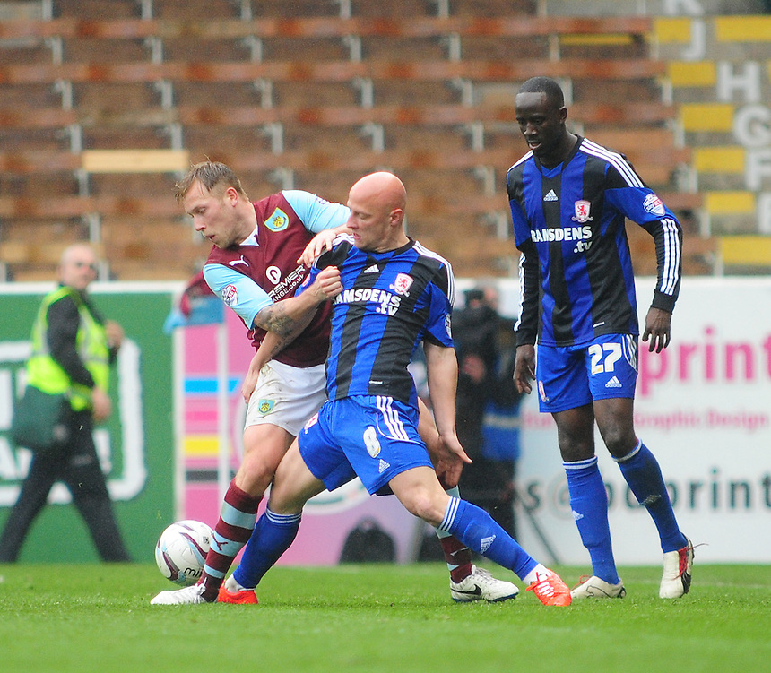 Burnley's Scott Arfield is fouled by Middlesbrough's Jozsef Varga <br /> <br /> Photo by Chris Vaughan/CameraSport<br /> <br /> Football - The Football League Sky Bet Championship - Burnley v Middlesbrough - Saturday 12th April 2014 - Turf Moor - Burnley<br /> <br /> &copy; CameraSport - 43 Linden Ave. Countesthorpe. Leicester. England. LE8 5PG - Tel: +44 (0) 116 277 4147 - admin@camerasport.com - www.camerasport.com