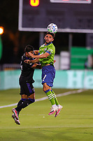 10th July 2020, Orlando, Florida, USA;  Seattle Sounders midfielder Cristian Roldan (7) goes up for a header during the soccer match between the Seattle Sounders and the San Jose Earthquakes on July 10, 2020, at ESPN Wide World of Sports Complex in Orlando, FL.