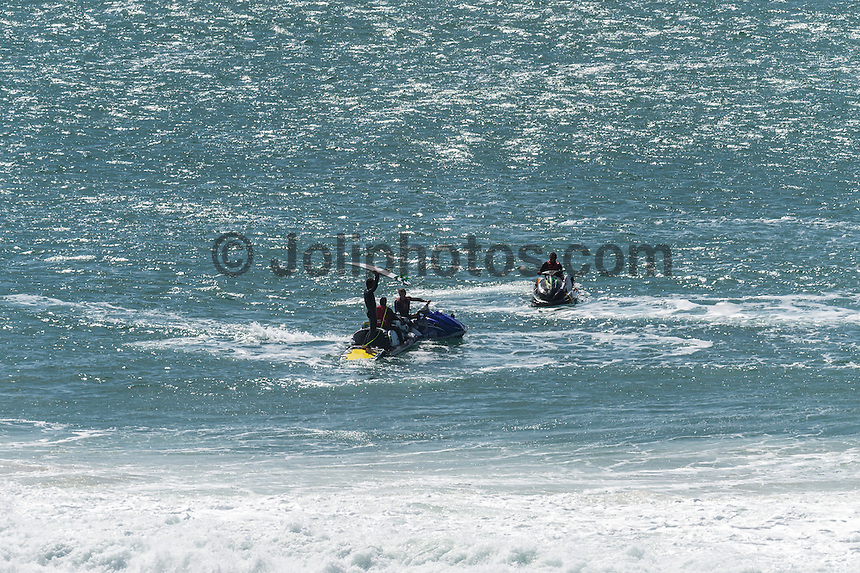 Coolangatta, Queensland Australia. (Thursday August 28, 2014) Joel Parkinson (AUS)  after scoring a double barrel at Kirra and claiming it with Dean Morrison (AUS), Damon Harvey (AUS) and Ryan Hipwood (AUS) on the Jet Ski's..–  The weather changed overnight with a howling wind from the south and heavy rain through the night. The swell that had been hitting the Gold Coast for the past 3 days had jumped overnight into the 6'-8' range. Inside Greenmount through to Kirra was protected from the howling winds and providing barrels from Big Groyne through to North Kirra. Photo: joliphotos.com
