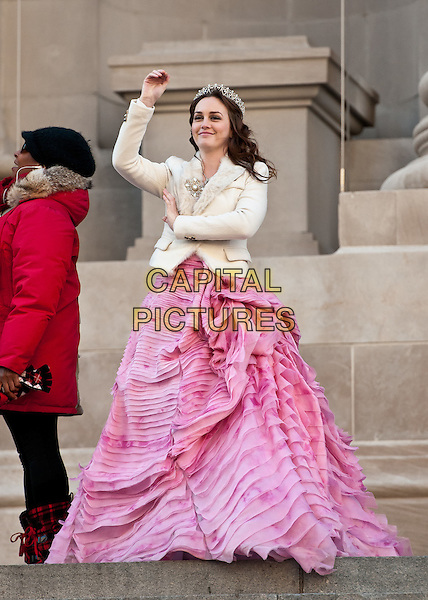 Leighton Meester.film 'Gossip Girl' on the steps of The Metropolitan Museum of Art, New York City, NY, USA..6th January 2012 .on the set of filming acting costume full length pink gown dress white jacket arm hand in air waving tiara.CAP/ADM/CS.© Chris Smith/AdMedia/Capital Pictures
