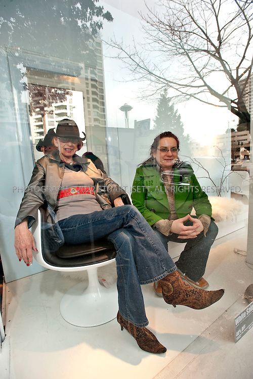 1/29/2009--Seattle, WA, USA...Chartreuse International, owned by Mari Franke (left, sitting on a Aarnio Style chair) and Rae McCullough (right) (mother/daughter) on 2609 1st Ave. Seattle, WA 98121 +1-206-328-4844. ..©2009 Stuart Isett. All rights reserved.