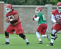 NWA Democrat-Gazette/MICHAEL WOODS &bull; @NWAMICHAELW<br /> University of Arkansas quarterback Brandon Allen (10) drops back to pass as the Razorbacks runs run drills during practice Thursday August 6, 2015 in Fayetteville.