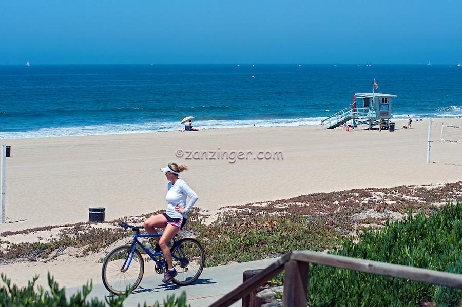 Manhattan; Beach; CA; Woman Riding Bike, No Hands, Lifeguard Station,