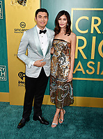 HOLLYWOOD, CA - AUGUST 07: Henry Golding (L) and Gemma Chan arrive at the Warner Bros. Pictures' 'Crazy Rich Asians' premiere at the TCL Chinese Theatre IMAX on August 7, 2018 in Hollywood, California.<br /> CAP/ROT/TM<br /> &copy;TM/ROT/Capital Pictures