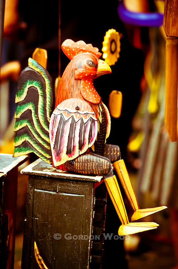 Wooden Rooster Figure on CD Box at Music Festival