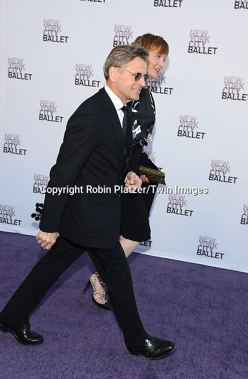 Mikhail Baryshnikov and date attends the New York City Ballet's 3rd Annual  Fall Fashion Gala on September 23, 2014 at David Koch Theatre in Lincoln Center in New York City. <br /> <br /> photo by Robin Platzer/Twin Images<br />  <br /> phone number 212-935-0770