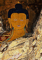 "Trongsa to Thimphu,Bhutan..Also along the road paintings of Buddha on Cliff face. (Chendepii) Paintings of Buddha & Guru Rinpoche from the Buddhist movie ""travelewrs & Magicians"" produced by Dzongsar Jamyang Khentse Rinpoche Nove. 2002"