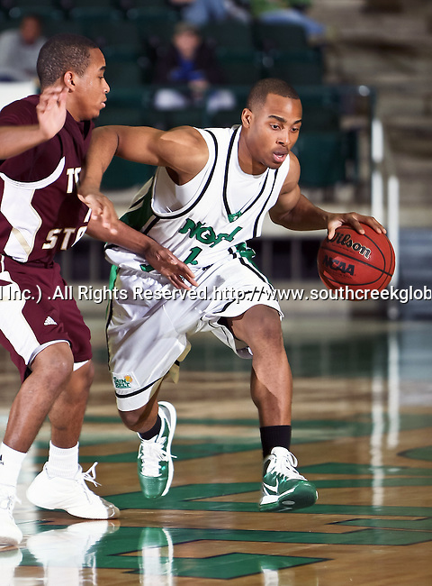 North Texas Mean Green guard Avery Redmond (12) drives the ball toward the basket in the game between the Texas State Bobcats and the University of North Texas Mean Green at the North Texas Coliseum,the Super Pit, in Denton, Texas. UNT defeated Texas State 85 to 62