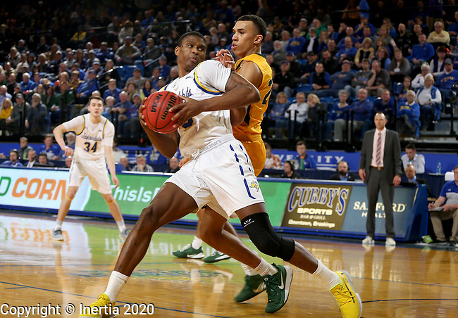 BROOKINGS, SD - JANUARY 22: Douglas Wilson #35 of the South Dakota State Jackrabbits spins toward the basket against Tyson Ward #24 of the North Dakota State Bison at Frost Arena on January 22, 2020 in Brookings, South Dakota. (Photo by Dave Eggen/Inertia)