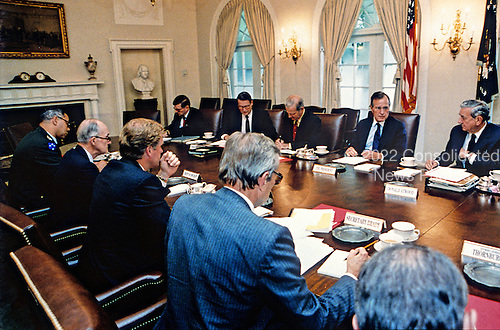United States President George H.W. Bush conducts a meeting of his national security advisors on the situation in the Middle East in the Cabinet Room of the White House in Washington, D.C. on August 9, 1990.<br /> Mandatory Credit: David Valdez / White House via CNP