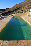 Swimming pool at tourist accommodation, Los Presillas Bajas, Cabo de Gata natural park, Almeria, Spain