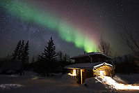 Northern lights and a log cabin in Wiseman, Alaska.